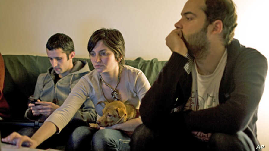 Three Portuguese workers, who started a social media campaign to vent their frustration at grim career prospects amid an acute economic crisis (file photo)