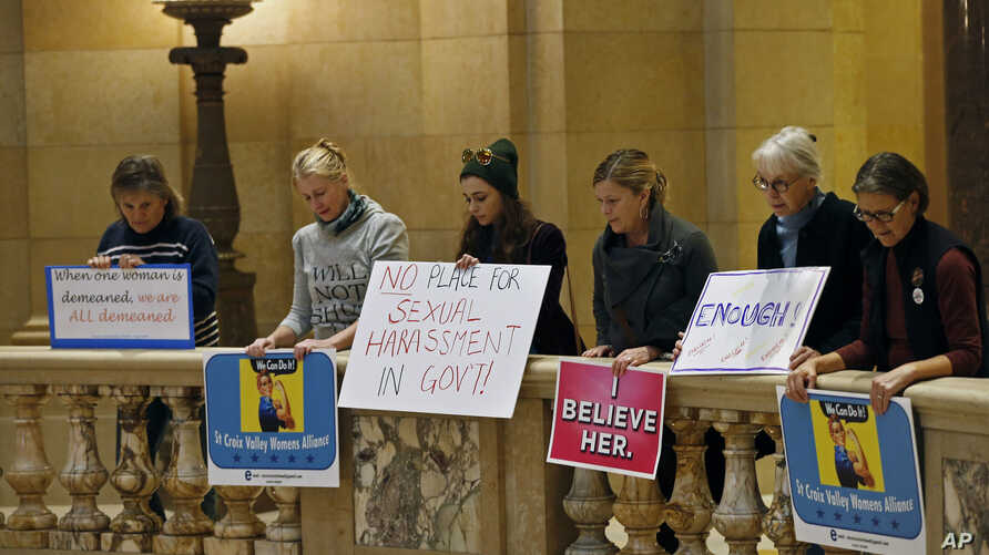 FILE - Women rally at the State Capitol in St. Paul, Minnesota, in response to a tide of sexual harassment allegations, Nov. 17, 2017.