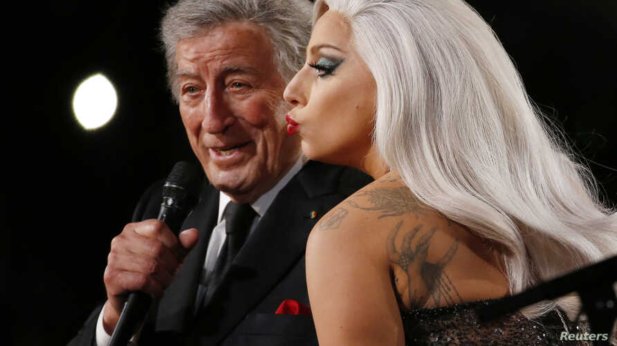 """Lady Gaga performs """"Cheek to Cheek"""" with Tony Bennett at the 57th annual Grammy Awards in Los Angeles, California, Feb. 8, 2015."""