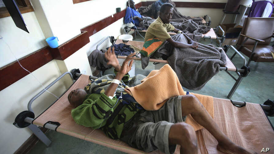 FILE - Cholera patients lie in beds in Budiriro clinic in Harare, Zimbabwe.