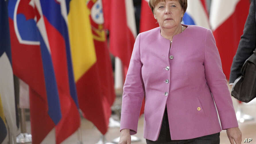FILE - German Chancellor Angela Merkel arrives for an EU summit at the Europa building in Brussels on March 9, 2017.