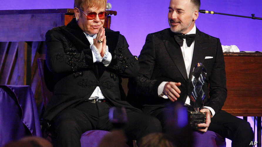 "Elton John, left, and David Furnish attend the Elton John AIDS Foundation's 17th annual ""An Enduring Vision"" benefit gala at Cipriani 42nd Street in New York, Nov. 5, 2018."