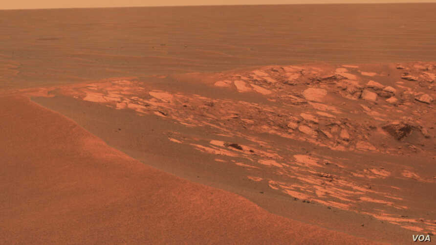 """A view of the surface of Mars taken at the """"Intrepid"""" crater by the Opportunity Mars Rover on November 11, 2010. (NASA/JPL-Caltech/Cornell University)"""