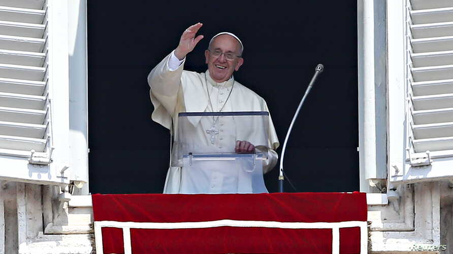 Pope Francis waves as he leads the Angelus prayer from the window of the Apostolic palace in Saint Peter's Square at the Vatican, Aug. 9, 2015.