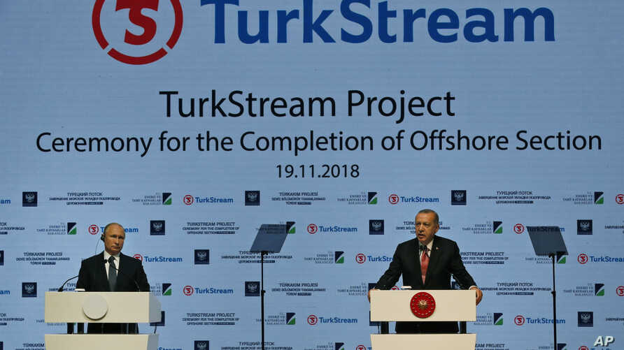 Russian President Vladimir Putin, left, and Turkey's President Recep Tayyip Erdogan, attend an event marking the completion of the offshore part of TurkStream natural gas pipeline that will carry natural gas from Russia to Turkey, in Istanbul, Nov. 1