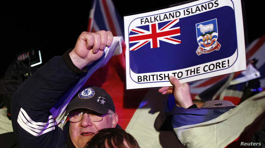 Falkland islanders react after hearing the results of the referendum in Stanley, March 11, 2013. Residents of the Falkland Islands voted almost unanimously to stay under British rule in a referendum that has inflamed a long-running sovereignty disput