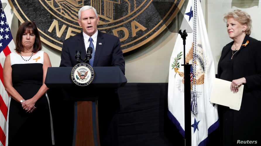 U.S. Vice President Mike Pence is joined by his wife, Karen, left, and Las Vegas Mayor Carolyn Goodman as he speaks in Las Vegas City Hall following a Unity Prayer Walk in Las Vegas, Nev., Oct. 7, 2017.