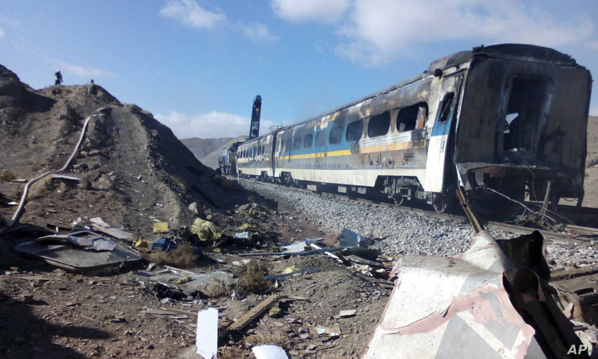 This picture released by Iranian Fars News Agency shows the scene of a train collision east of Tehran, Nov. 25, 2016.