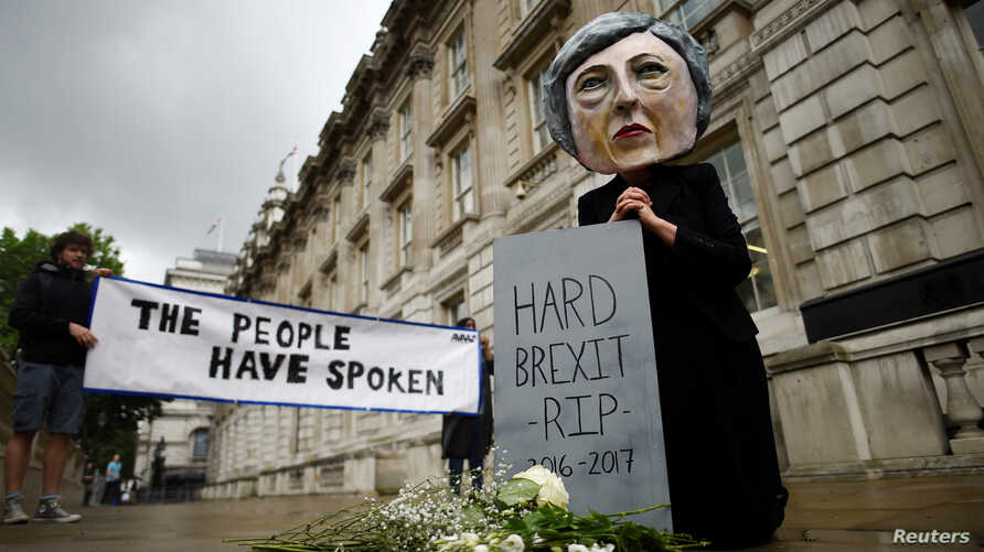 A protester wearing a Theresa May mask is seen the day after Britain's election in London, June 9, 2017.