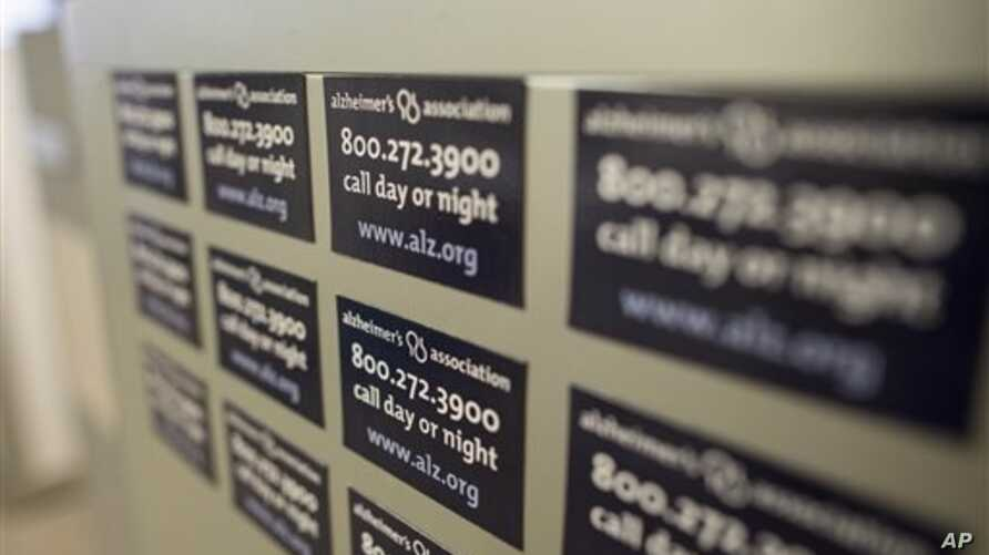 Cabinet magnets at the Alzheimer's Association Headquarters advertise the group's help line, Chicago, Illinois, June 21, 2013.