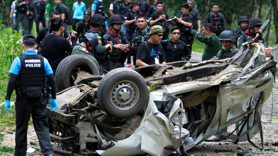 Military personnel inspect the site of a bomb attack at Krong Pinang District district in the troubled southern province of Yala, Thailand, Sept. 23, 2016.