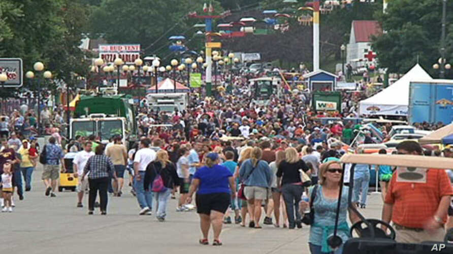 A crowd walks along part of the fair grounds at the Iowa State Fair, in the state capital Des Moines, August 12, 2011