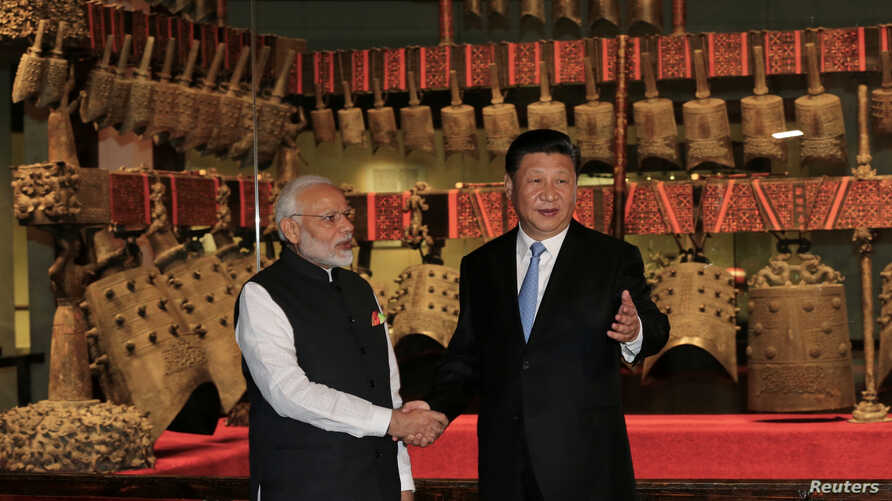 Chinese President Xi Jinping and Indian Prime Minister Narendra Modi shake hands as they visit the Hubei Provincial Museum in Wuhan, Hubei province, China, April 27, 2018.