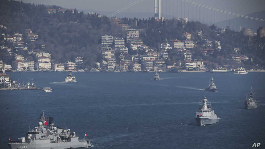 FILE - Turkish Navy vessels cross the Bosporus Strait in Istanbul, March 9, 2019, upon completion of massive military drills.