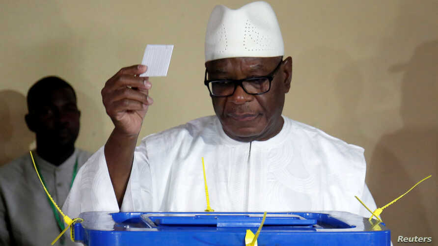 Ibrahim Boubacar Keita, President of Mali and candidate for Rally for Mali party (RPM), casts his vote at a polling station during a run-off presidential election in Bamako, Aug. 12, 2018.
