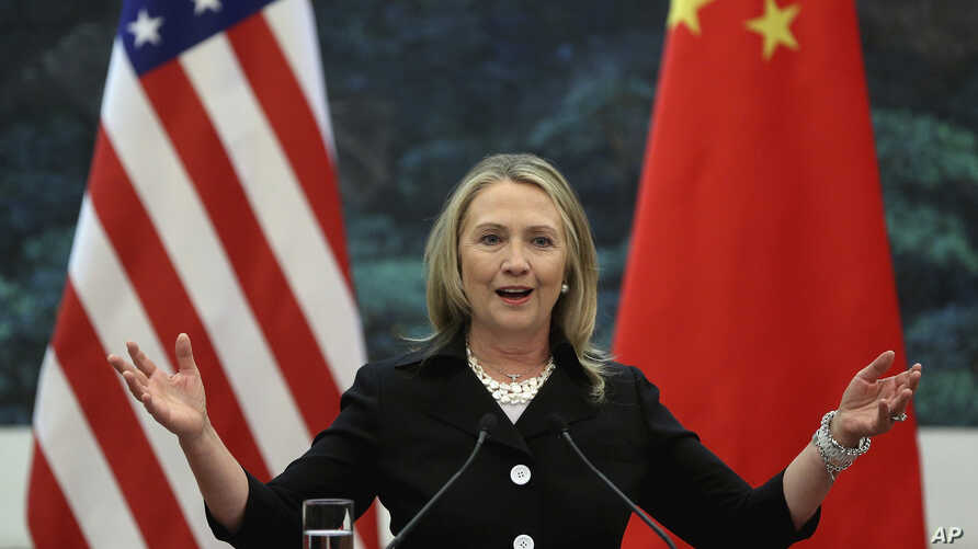 FILE - U.S. Secretary of State Hillary Clinton speaks during her joint conference with Chinese Foreign Minister Yang Jiechi at the Great Hall of the People in Beijing.