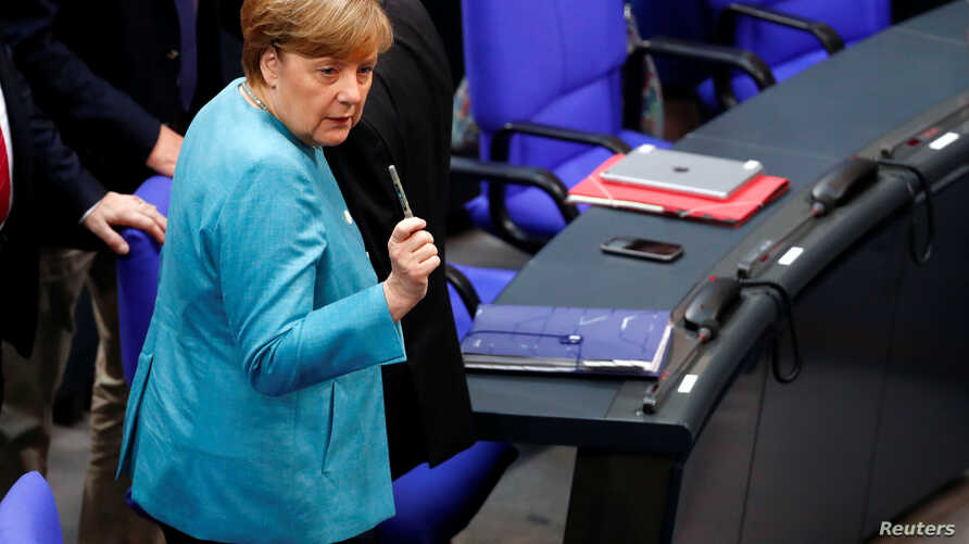FILE - German Chancellor Angela Merkel attends a session at the lower house of parliament Bundestag in Berlin, Germany, June 29, 2017.