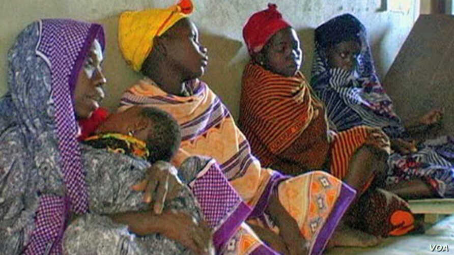 African women waiting for care.