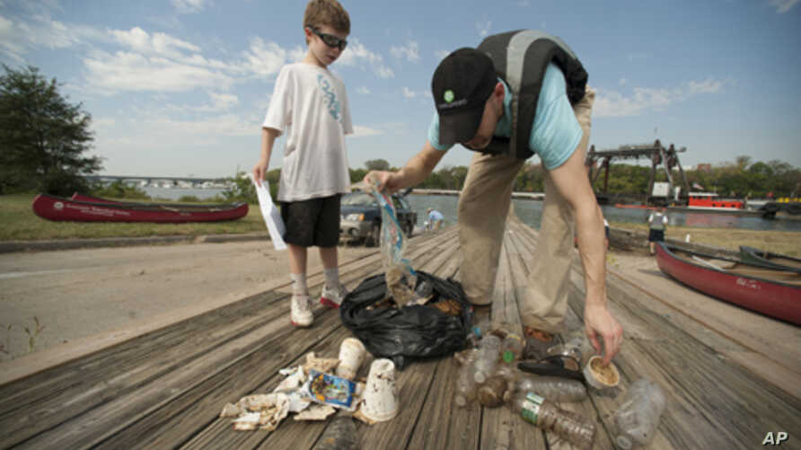 Volunteers participating in the International Coastal Cleanup collect litter in the Anacostia area of Washington, DC.