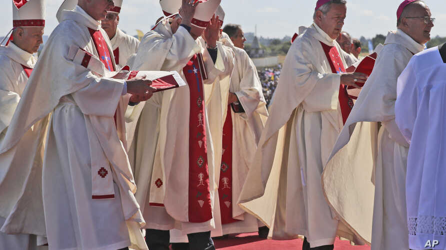 Bishop Juan Barros (2nd-R) arrives to attend a Mass celebrated by Pope Francis at the Maquehue Air Base in Temuco, Chile, Jan. 17, 2018.