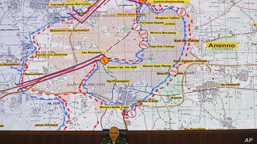FILE - Lt. Gen. Sergei Rudskoi of the Russian military's General Staff speaks, in front of a map of the Aleppo area in Syria, at a briefing at the Russian Defense Ministry's headquarters in Moscow, Russia, Oct. 19, 2016.