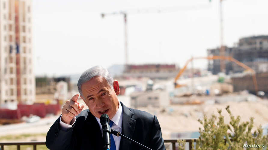 FILE - Israeli Prime Minister Benjamin Netanyahu delivers a statement in front of new construction, in the Jewish settlement known to Israelis as Har Homa and to Palestinians as Jabal Abu Ghneim, in an area of the West Bank that Israel captured in a