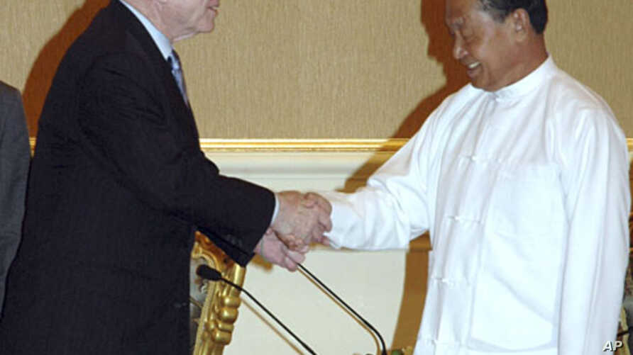 U.S. Sen. John McCain, left, is greeted by Myanmar's Vice President Thiha Thura Tin Aung Myint Oo during their meeting at the President's House in Nay Pyi Taw, Myanmar, June 1, 2011