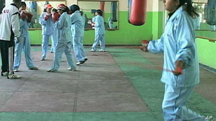 A group of young women are learning to box in the same Kabul stadium that was once used for Taliban executions, Kabul, Afghanistan, 2011.