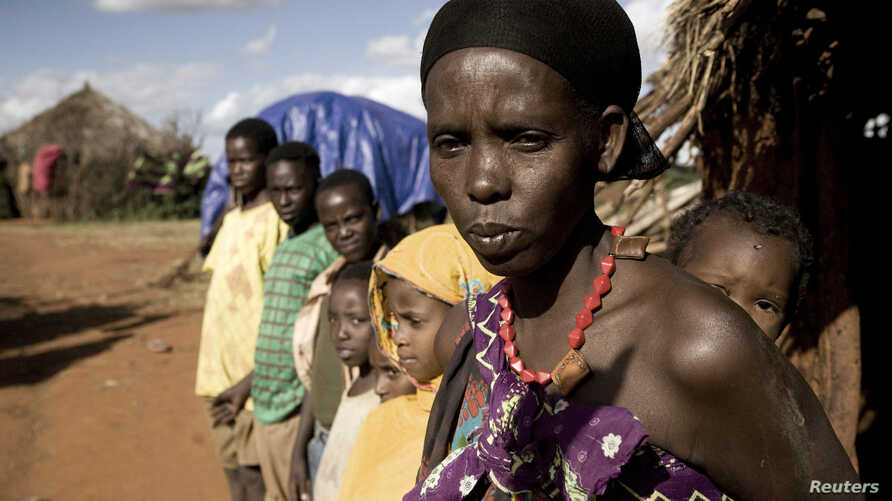 Karsi Tadicha and her children stand next to their house in Bule Duba village, on the outskirts of Moyale, Ethiopia, June 2009. (file photo)