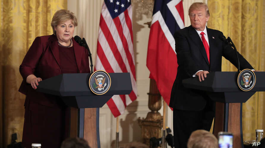 Norwegian Prime Minister Erna Solberg, speaks during a joint news conference with President Donald Trump, in the East Room of the White House in Washington, Jan. 10, 2018.
