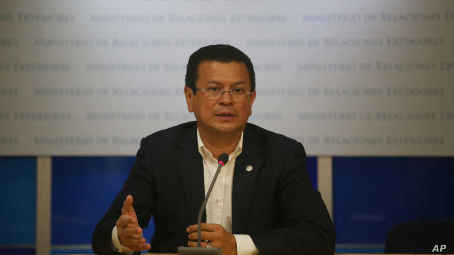 FILE - El Salvador's Foreign Minister Hugo Martinez is seen at a news conference in San Salvador, El Salvador, June 13, 2017. Martinez is currently in the U.S. lobbying for the extension of two programs that shield the country's nationals in the U.S.