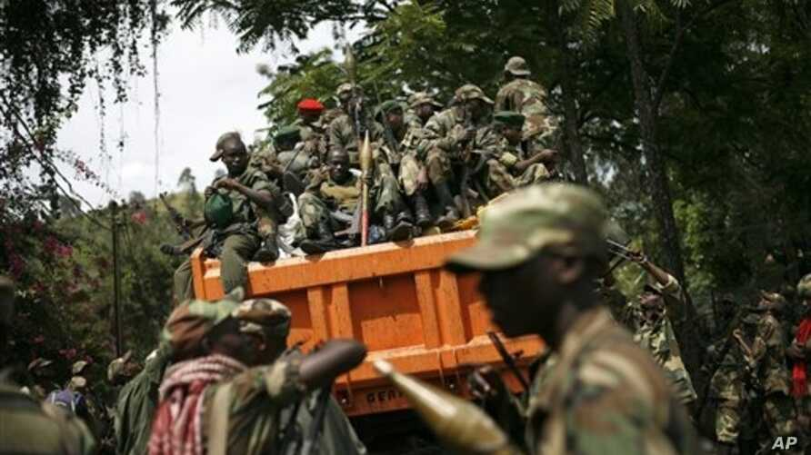 M23 rebels sit in a vehicle as they withdraw from the eastern Congo town of Goma, Dec. 2012 file photo.