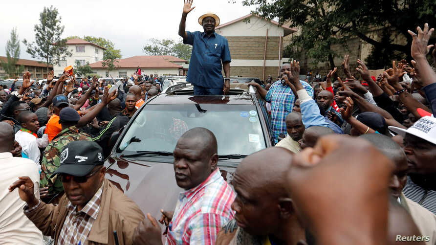 Kenyan opposition leader Raila Odinga, of the National Super Alliance (NASA) coalition, waves to supporters as he leaves the St. Stephen's cathedral after attending a church service in Nairobi, Sept. 3, 2017.