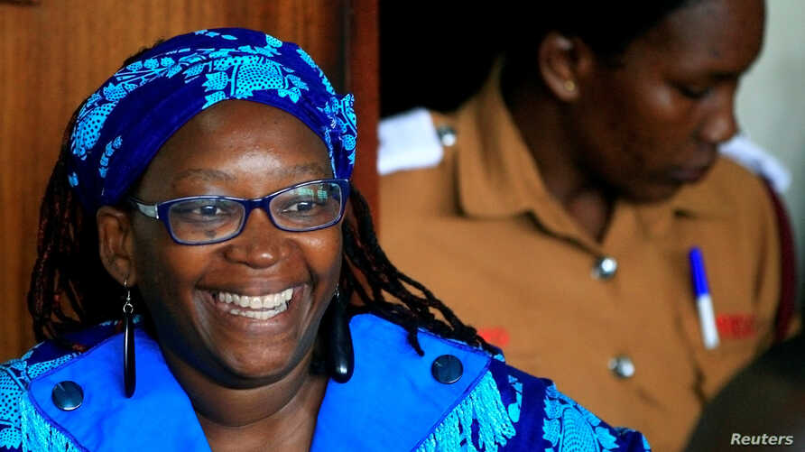 Ugandan prominent academic Stella Nyanzi smiles as she appears at Buganda Road court charged with cybercrimes after she posted profanity-filled denunciations of president Yoweri Museveni on Facebook, in Kampala, Uganda, April 25, 2017.