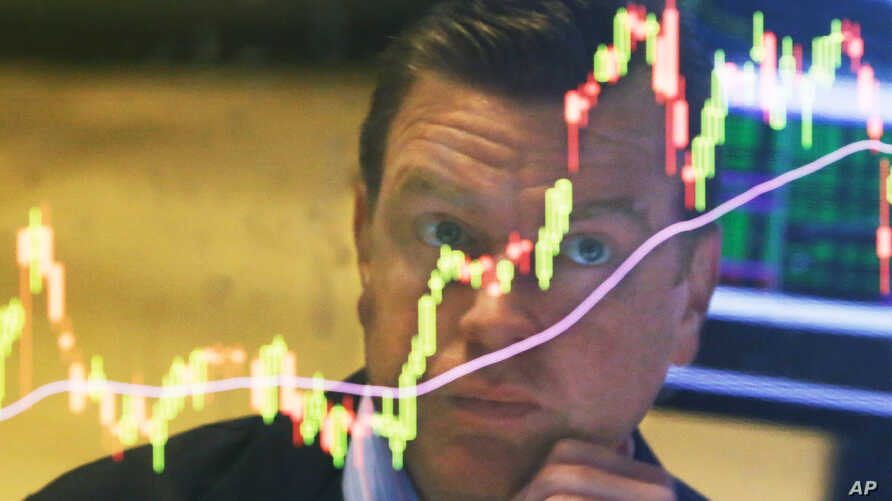 Specialist Michael O'Mara works on the floor of the New York Stock Exchange, Aug. 25, 2015.