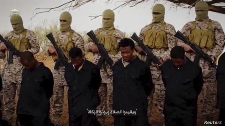Militants from the so-called Islamic State stand behind what are said to be Ethiopian Christians in Libya, in this still image from an undated video posted to a social media website on April 19, 2015.