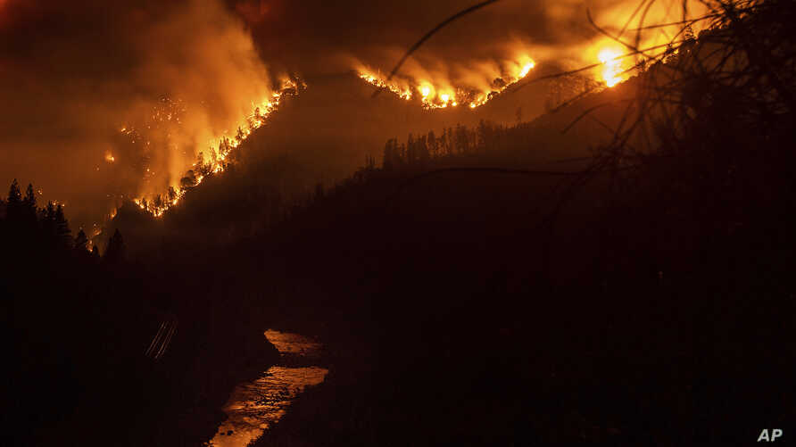 The Delta Fire burns in the Shasta-Trinity National Forest in California, Sept. 5, 2018. Fire officials said the wildfire roaring through timber and brush in Northern California tripled in size overnight, prompting mandatory evacuations.
