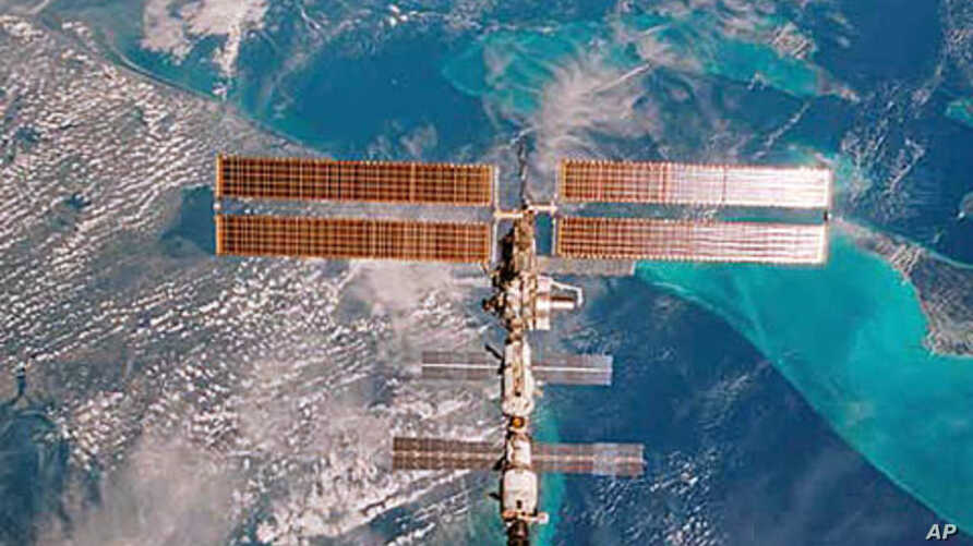 The International Space Station is seen over Miami, Florida, in this 35mm frame photographed by STS-108 Commander DomInic Gorie aboard the Space Shuttle Endeavour (file photo)