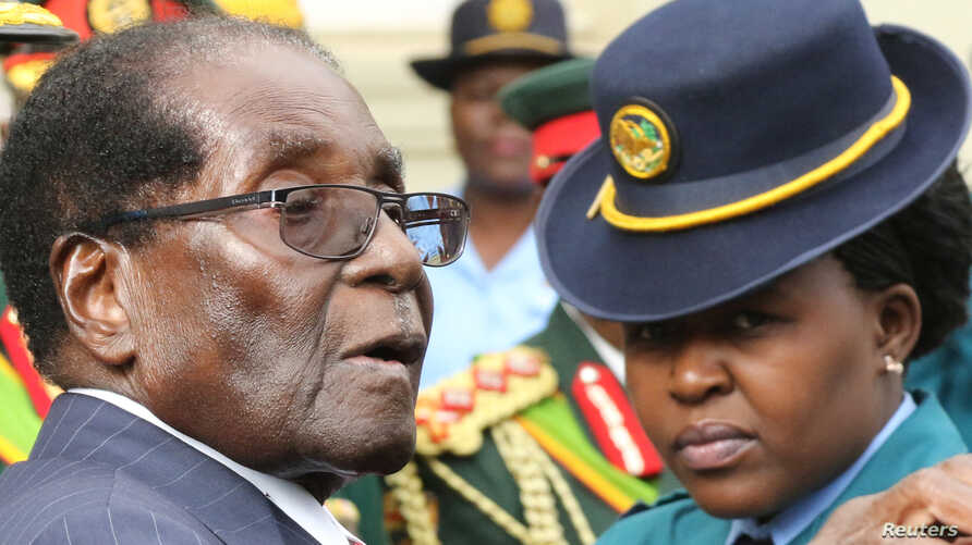 President Robert Mugabe leaves the parliament building after delivering his State Of the Nation address in Harare, Zimbabwe, Dec. 6, 2016.