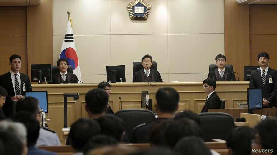 Judges sit to preside over verdicts of the sunken South Korean ferry Sewol's crew members are charged with negligence and abandonment of passengers in the disaster at Gwangju High Court in Gwangju, South Korea, April 28, 2015.