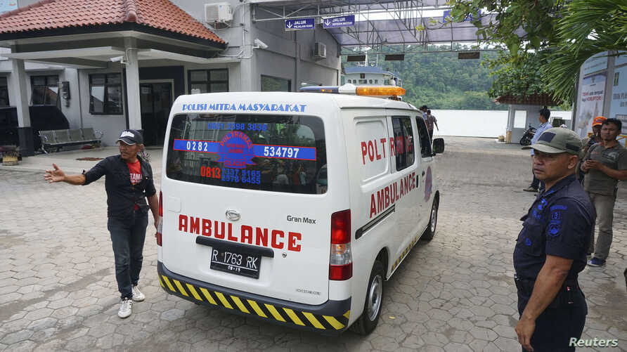 An ambulance carrying a coffin arrives at the ferry crossing to Nusa Kambangan prison at Wijayapura quay, Cilacap, Central Java, January 17, 2015.