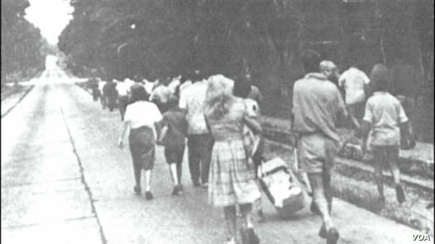 Freed hostages walk toward the airfield in Stanleyville for evacuation, November 1964.
