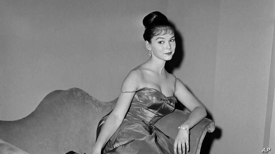 """FILE - Actress Yvonne Craig poses on the set of """"The Gene Krupa Story,"""" in Los Angeles, Calif., July 11, 1959."""