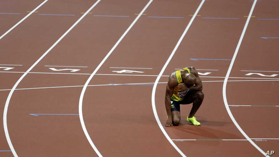FILE - A sprinter is seen resting after a 100-meter race.