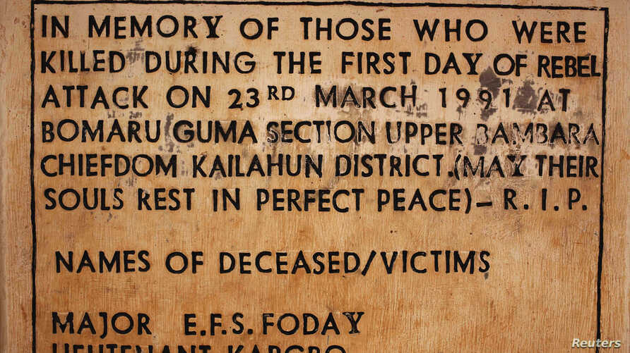 FILE -  A sign commemorating the start of the civil war is displayed April 22, 2012, at a memorial site where the conflict began, in the village of Bomaru, eastern Sierra Leone. Sierra Leone's 11-year conflict from 1991-2002 left over 50,000 dead and