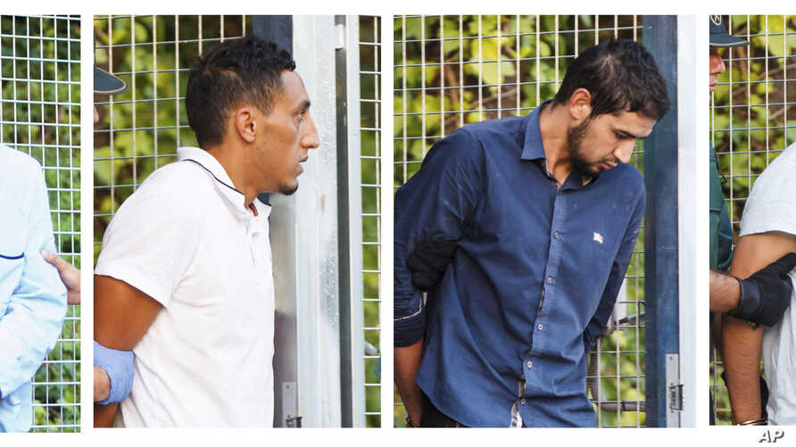 In this combination photo, four un-named alleged members of a terror cell accused of killing 15 people in attacks in Barcelona leaves a Civil Guard base on the outskirts of Madrid before appearing in court in Madrid, Spain, Aug. 22, 2017.