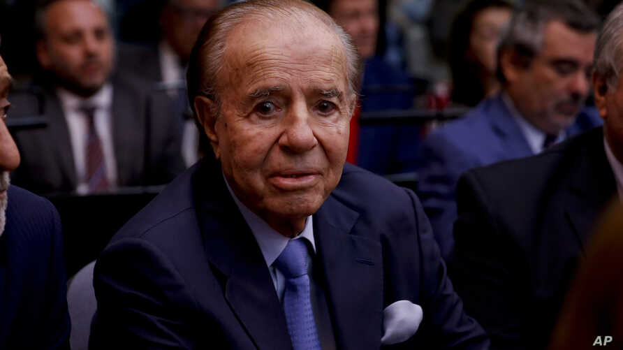 Former Argentine President Carlos Menem sits in a courthouse in Buenos Aires, Feb. 28, 2019, ahead of the verdict in a trial in which he and other former officials were accused of hampering the investigation of the attack on a Jewish center in Buenos