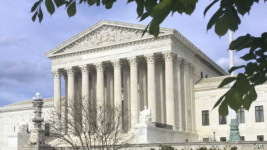 FILE - The Supreme Court in Washington. The court ruled, June 14, 2018, that U.S. courts do not have to accept as conclusive foreign governments' explanations of their own laws.