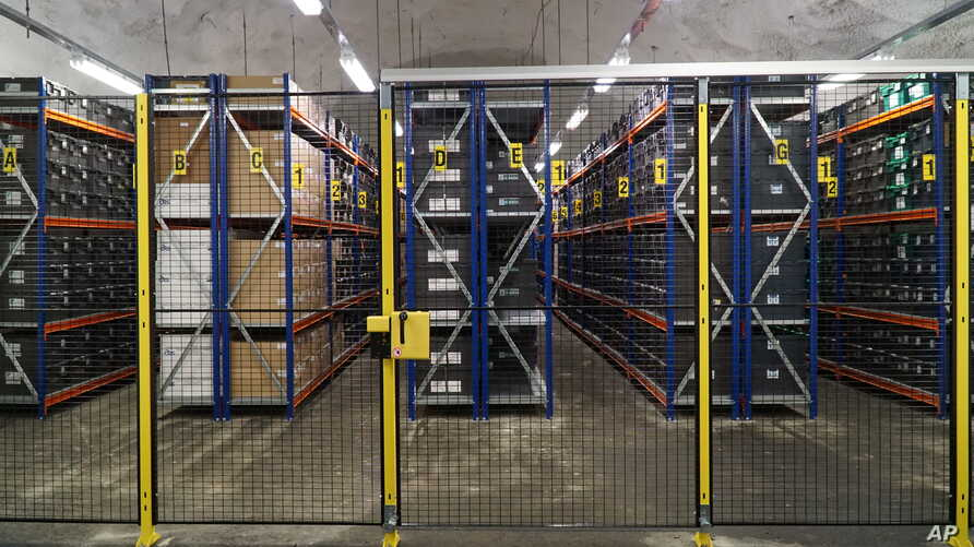 FILE - In this photo taken Oct. 18, 2015, rows of boxes containing seed samples stored inside the Global Seed Vault in Svalbard, Norway.