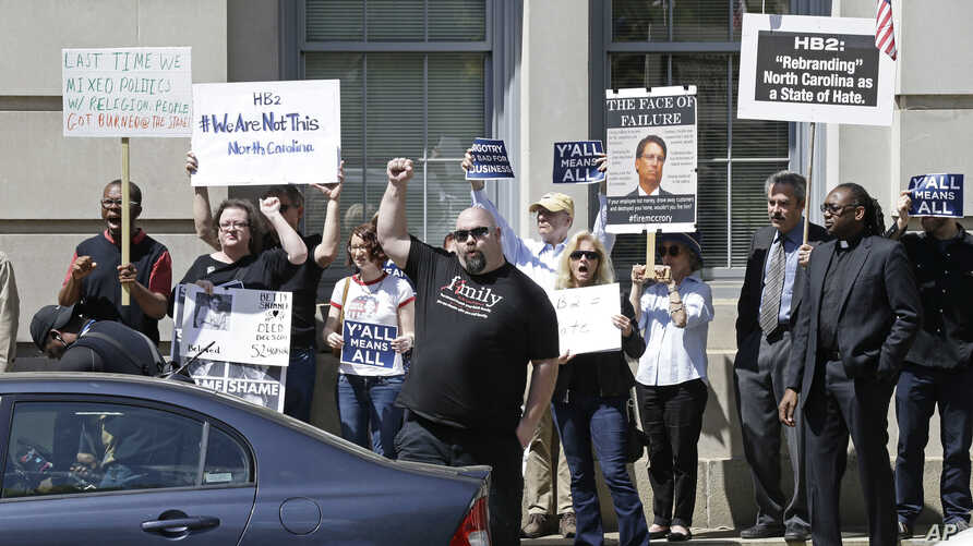 Opponents of House Bill 2 protest across the street from the North Carolina State Capitol in Raleigh, N.C., April 11, 2016.